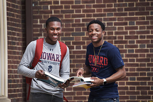 Howard students with books